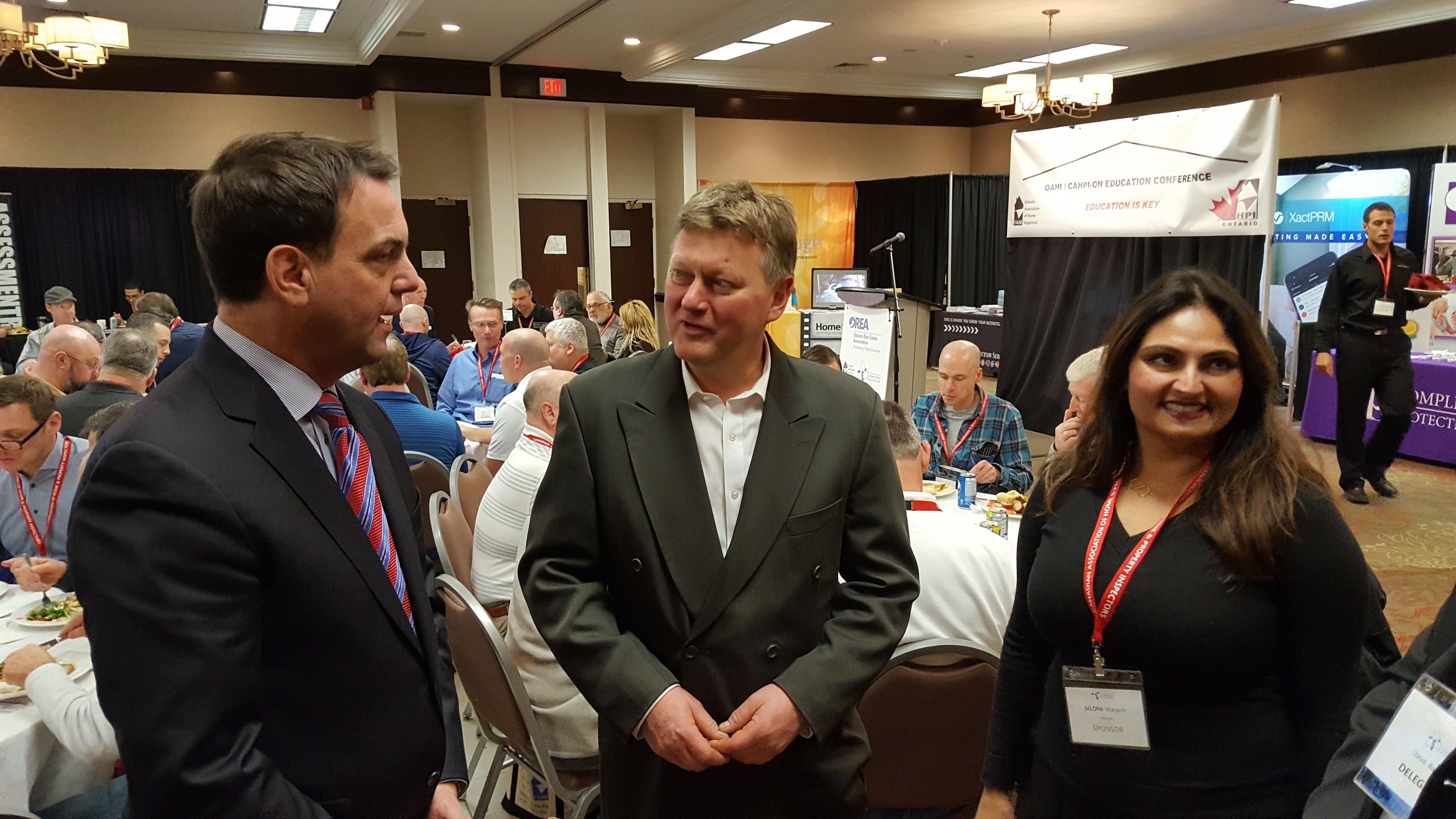 OREA's Tim Hudak with OAHI's Murray Parish and Siloni Waraich of Tarion